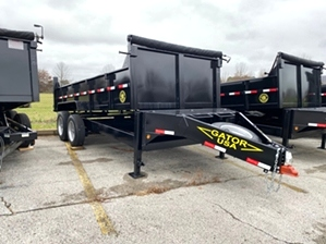 Dump Trailer 7x14 16,000 lb  Dump Trailer 7x14 16,000 lb. Heavy duty bumper pull design features dual jacks, a mounted spare tire, large chain storage box, and is 16,000 GVW rated.